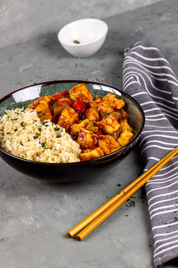 vegan sticky glazed tofu with rice in sweet sour sauce
