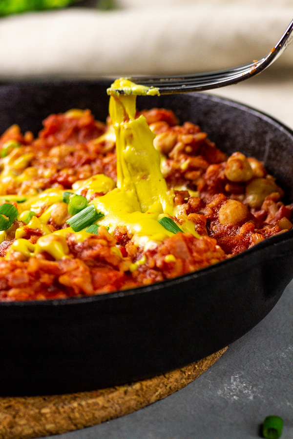 vegan enchilada skillet with rice and vegan cheese sauce