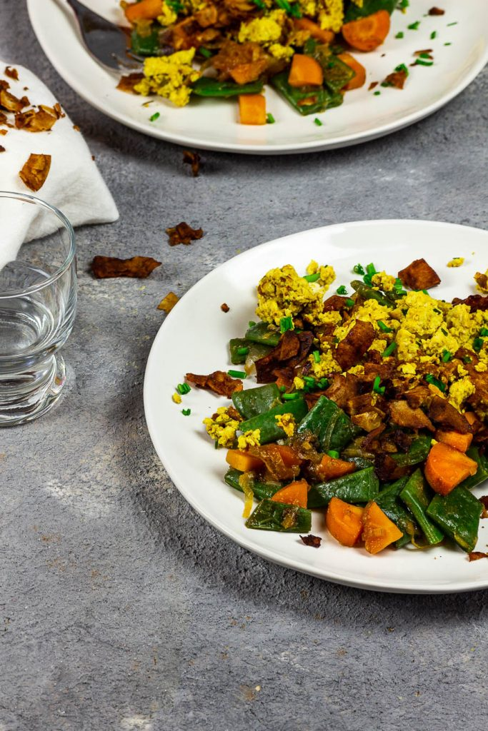Vegan scrambled eggs and coconut bacon