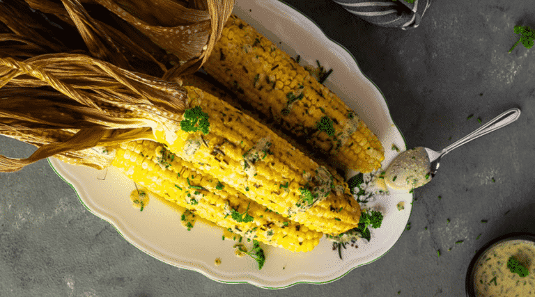 Vegan corn on the cob with parsley chive tahini sauce