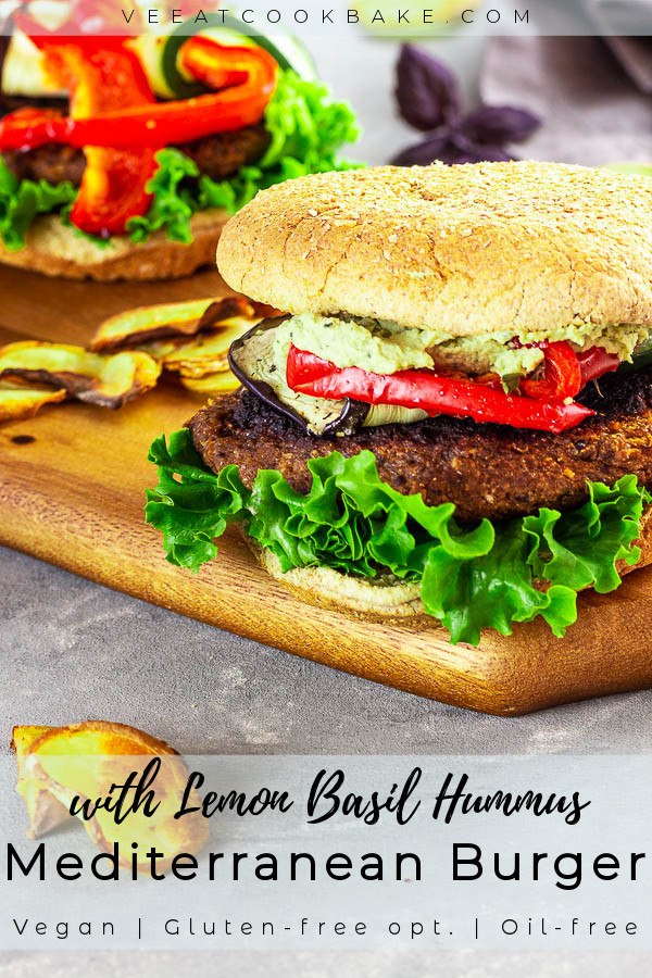 Two vegan Mediterranean Burgers with Lemon Basil Hummus on a wood board