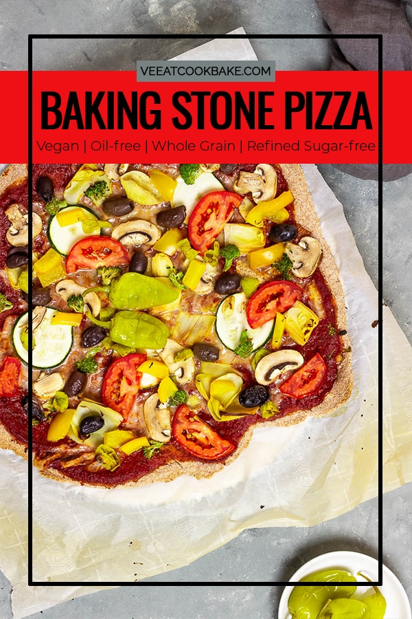 A baking stone baked vegan Pizza with a wfpb whole grain crust and an oil-free & sugar-free pizza sauce