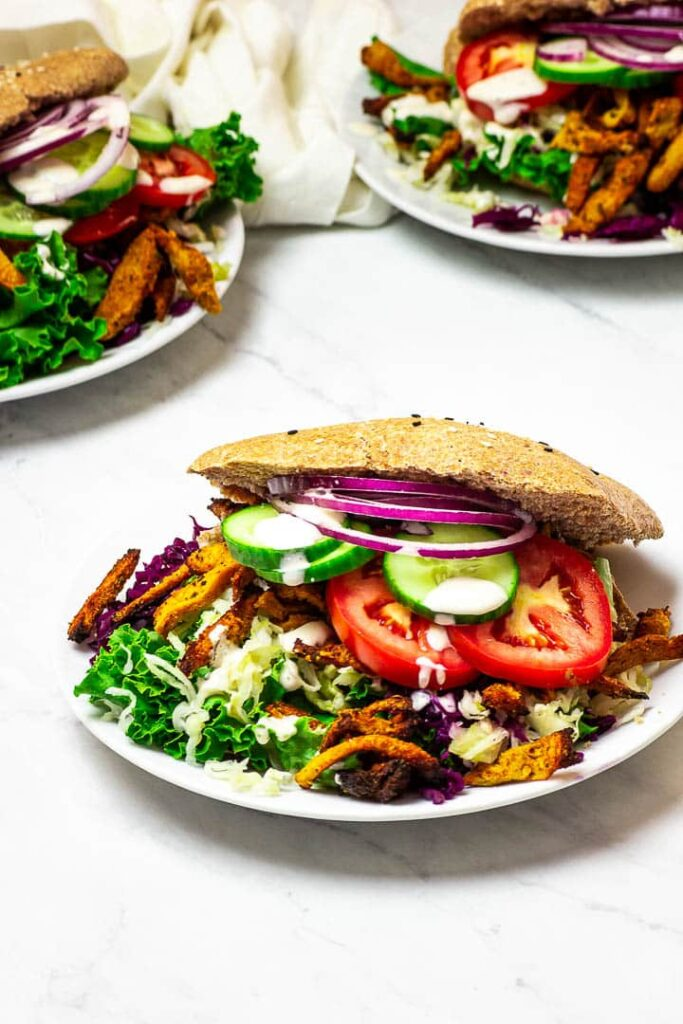 Vegan Doner Kebab with whole spelt / wheat kebab bread, coleslaw, soy curls / seitan and kebab sauce.