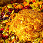 Vegan Roasted whole Cauliflower for your thanksgiving center piece. Cripsy Roasted with a turkey marinade.