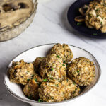 Vegan Semmelknödel are German Bread Dumplings. Presentation in a bowl with some mushroom stroganoff