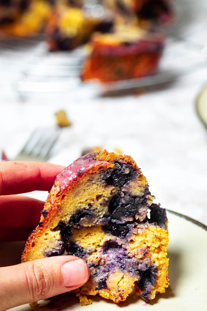 Close up of one piece of vegan blueberry bundt cake