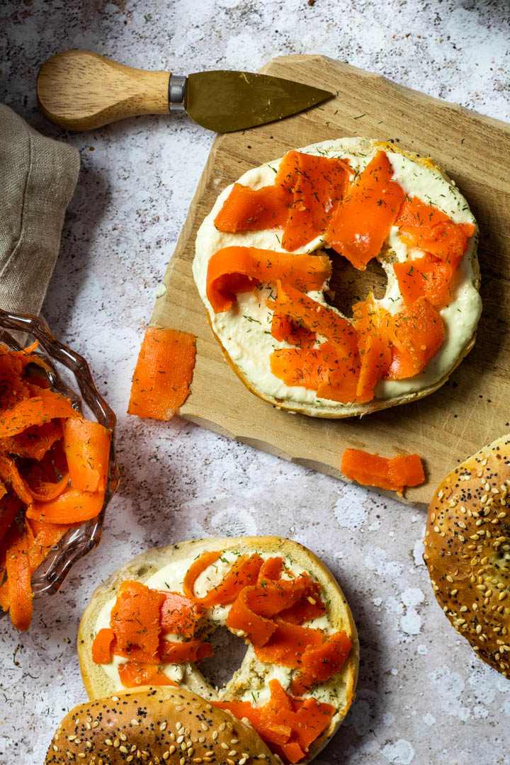 Vegan smoked salmon made with carrots. Wfpb carrot lox on a bagel with homemade oil-free horseradish dip