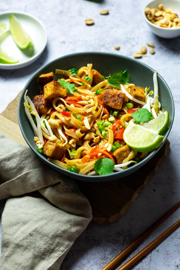 Vegan WFPB Tofu Pad Thai made without oil. Made with sprouts, carrots, baked tofu (vegetarian)