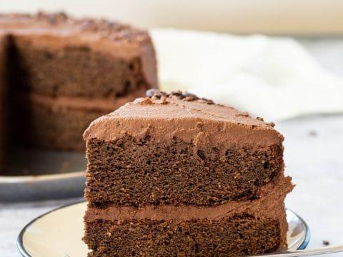 Close up of one piece of vegan chocolate layer cake