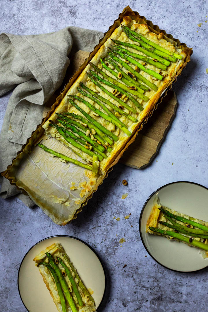 Vegan Asparagus Tart with Puff Pastry and a Creamy Cheese with two plates with pieces of the asparagus tart.
