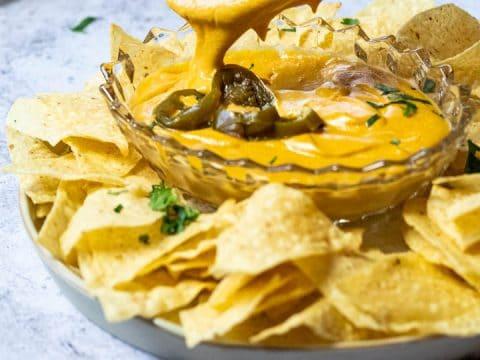 Dipped Chip in vegan nacho cheese sauce