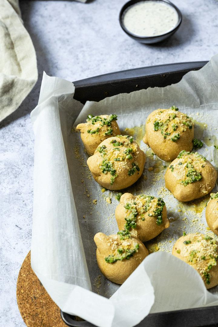 Vegan Garlic Knots on a Baking Sheet