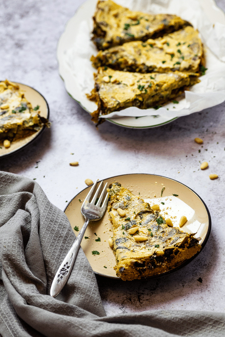Vegan leek quiche with a platter and two plates