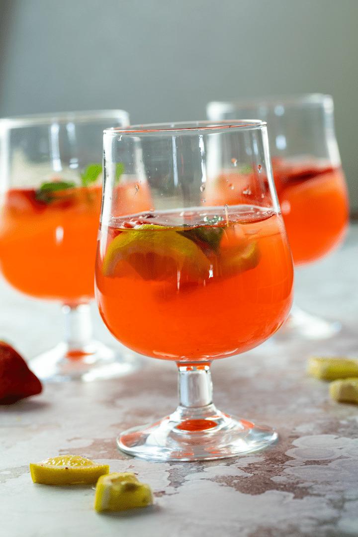 3 glasses with sugar-free strawberry basil lemonade