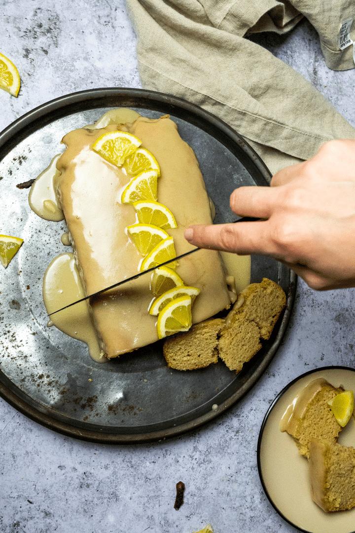 Cutting a vegan lemon loaf