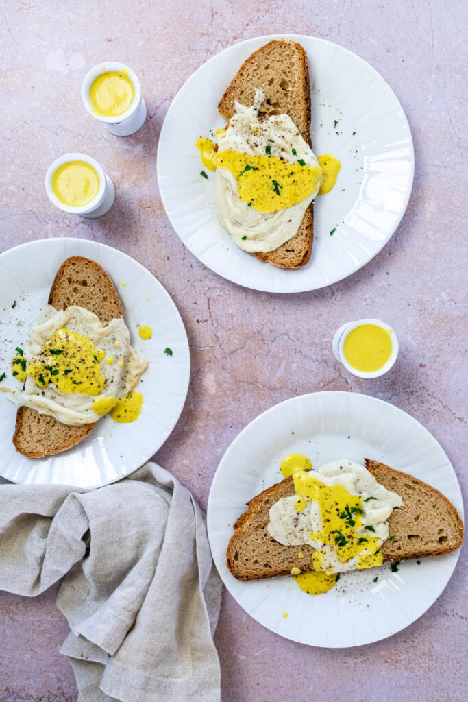 Vegan Sunny Side up egg on 3 different plates.