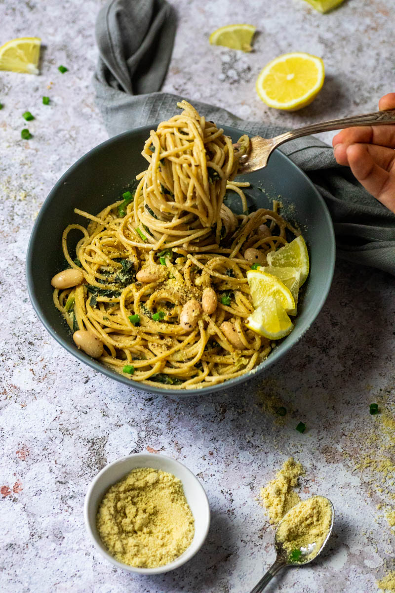 Vegan Lemon Pasta in a bowl with a fork full of spaghetti