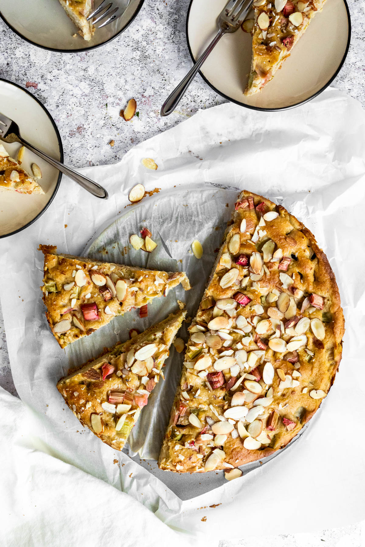 Whole Rhubarb Cake with 5 slices .
