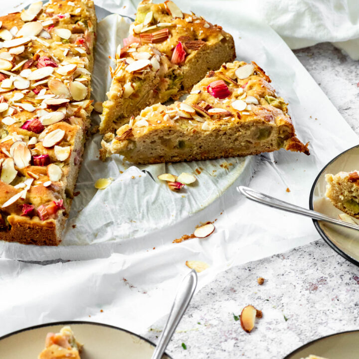 Vegan Rhubarb cake with a sliced piece in focus