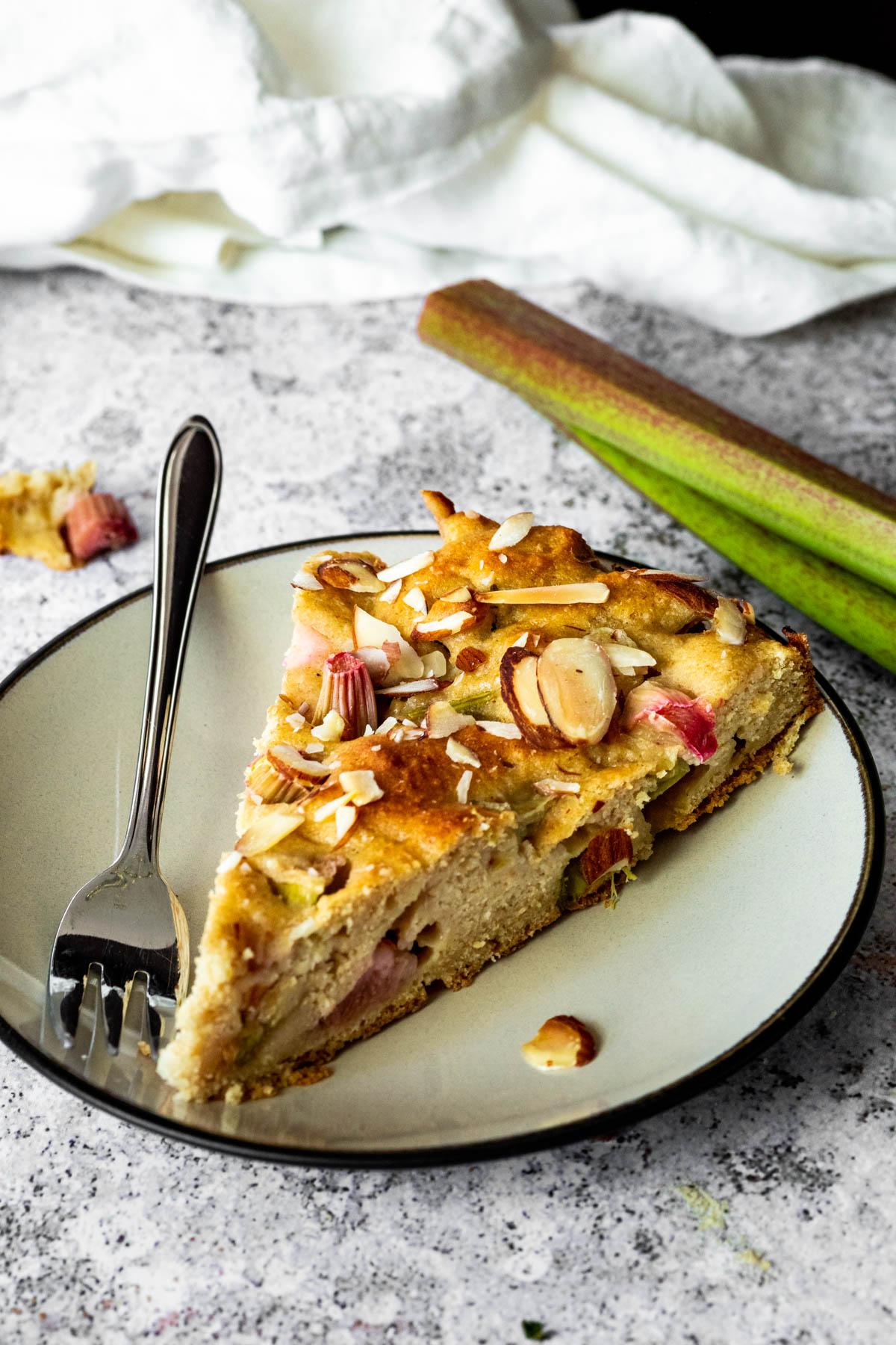 one vegan rhubarb cake slice on a plate