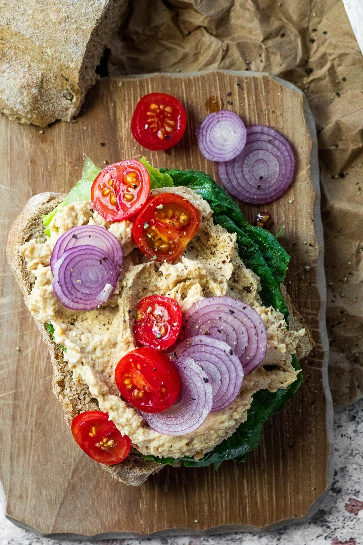 Close up of an open vegan tuna salad sandwich