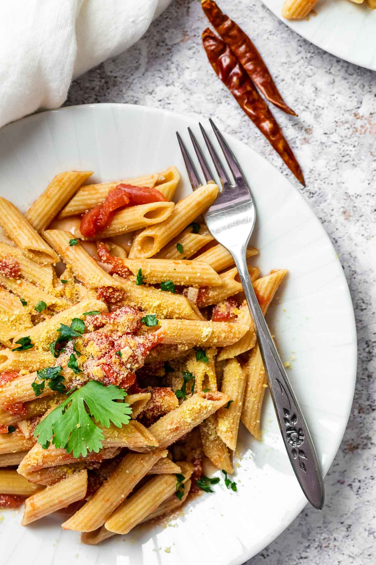 Close up of a plate with vegan arrabiata sauce and penne.
