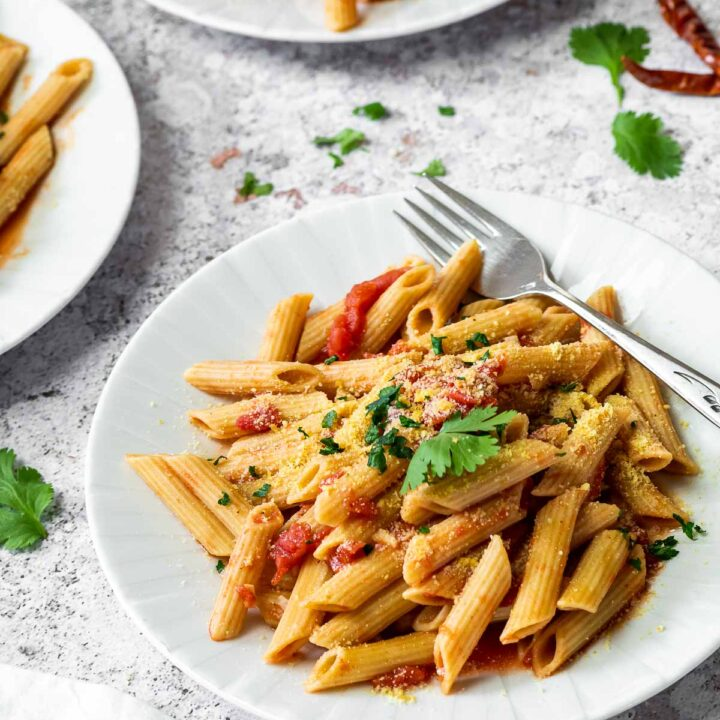 Three Plates with Penne in arrabiata sauce