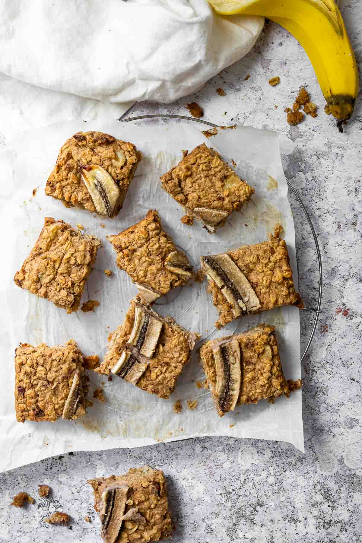 Oat Bars with Banana on a wire rack with parchment paper.