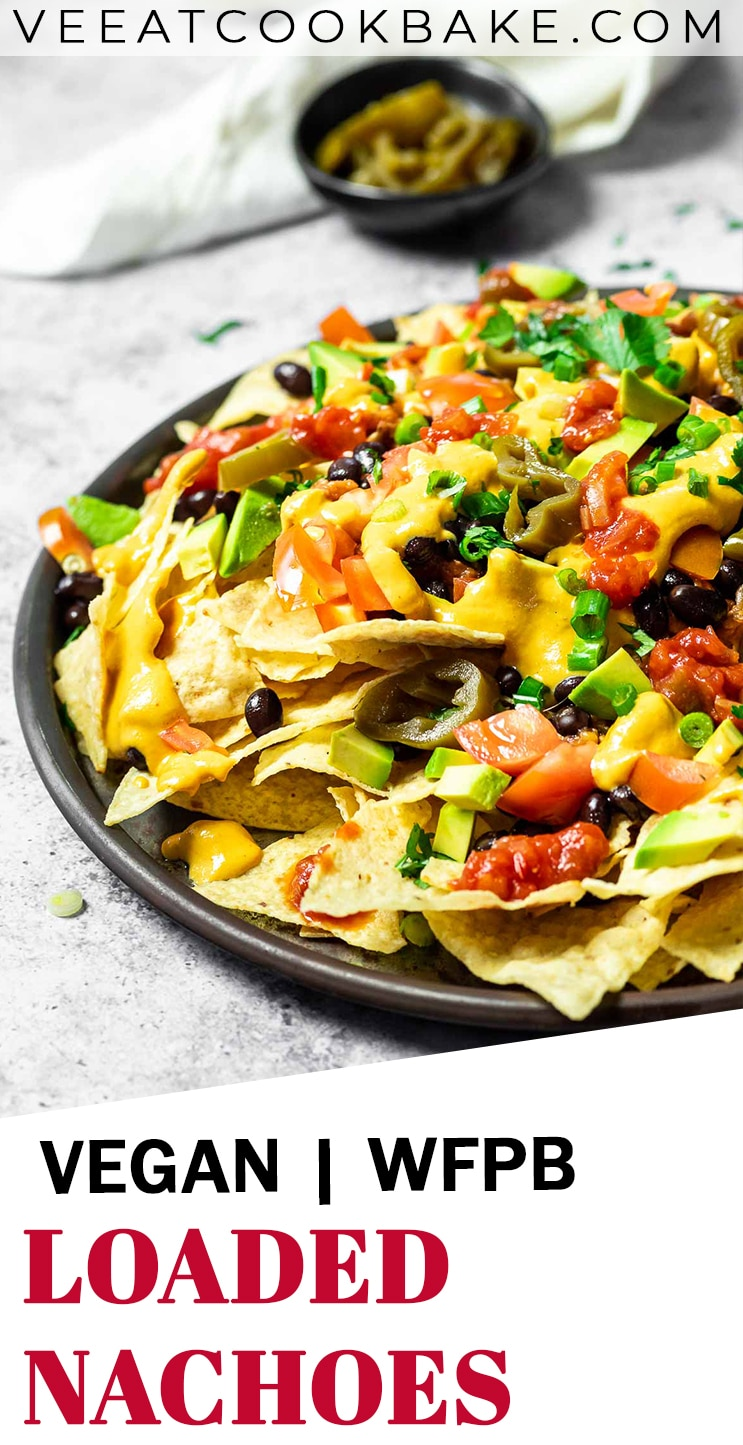 Vegan loaded nachos served on a platter with text