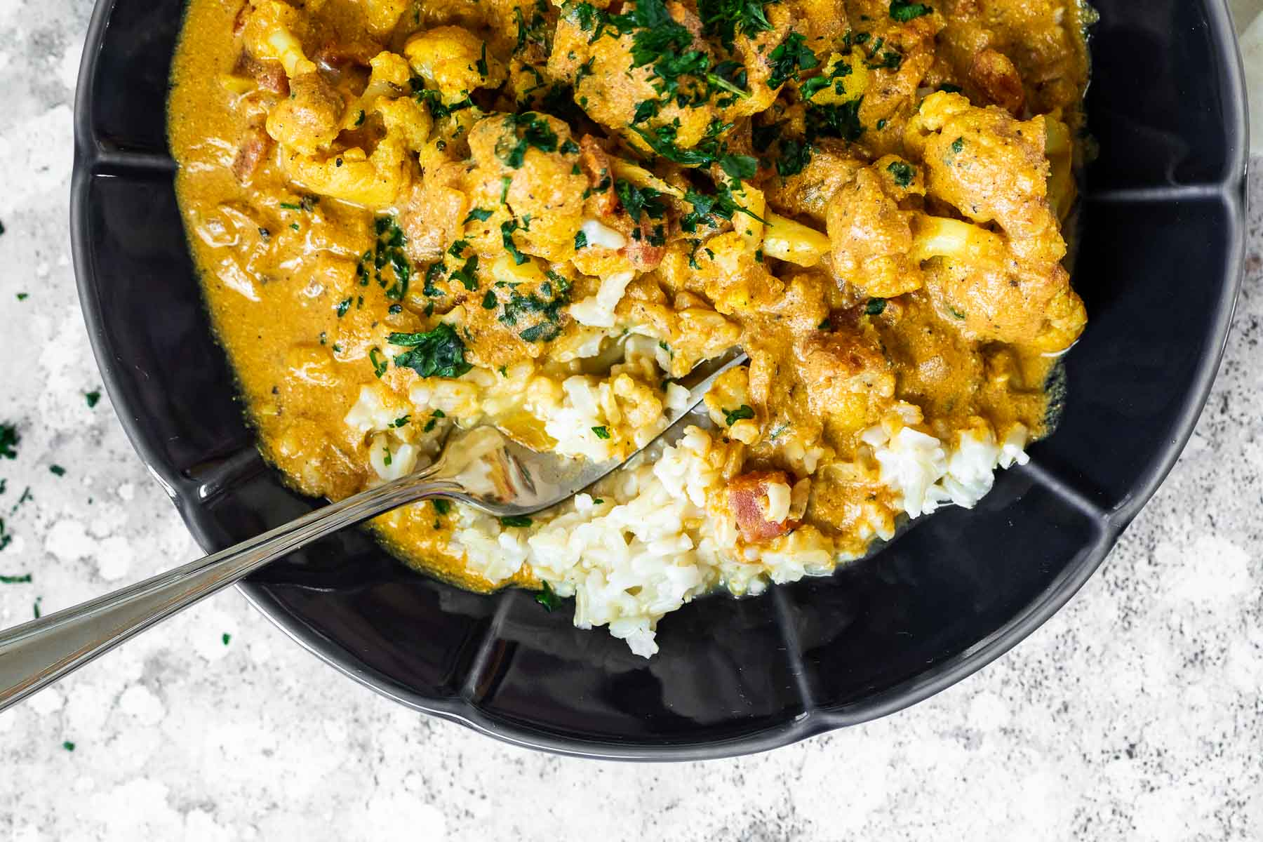 Close up of a bowl with vegan butter chicken with cauliflower