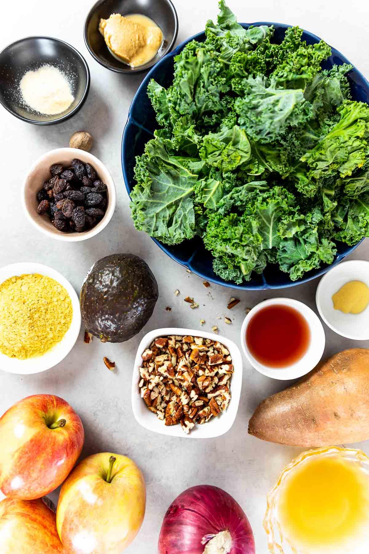 Ingredients shot of vegan kale salad with apples, sweet potato