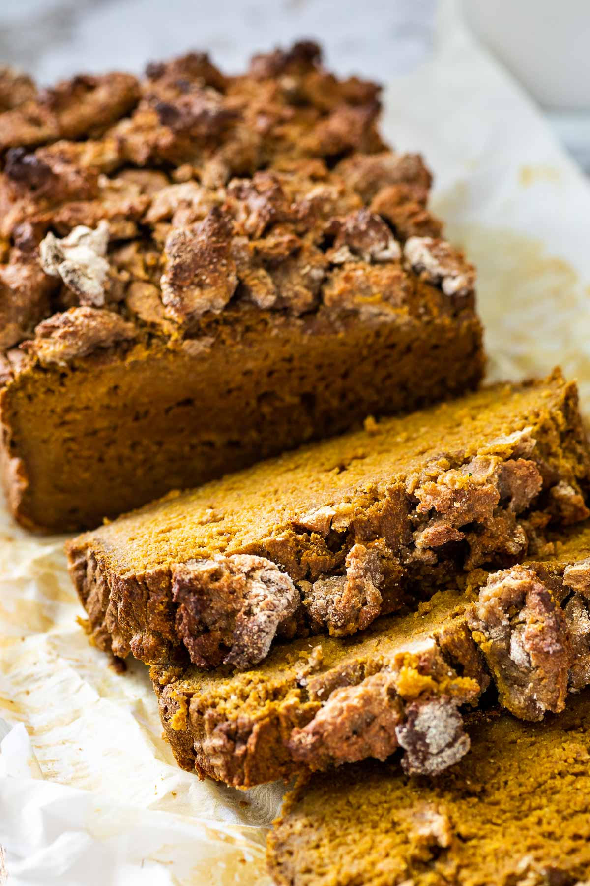 Straight view of the sliced pumpkin bread loaf