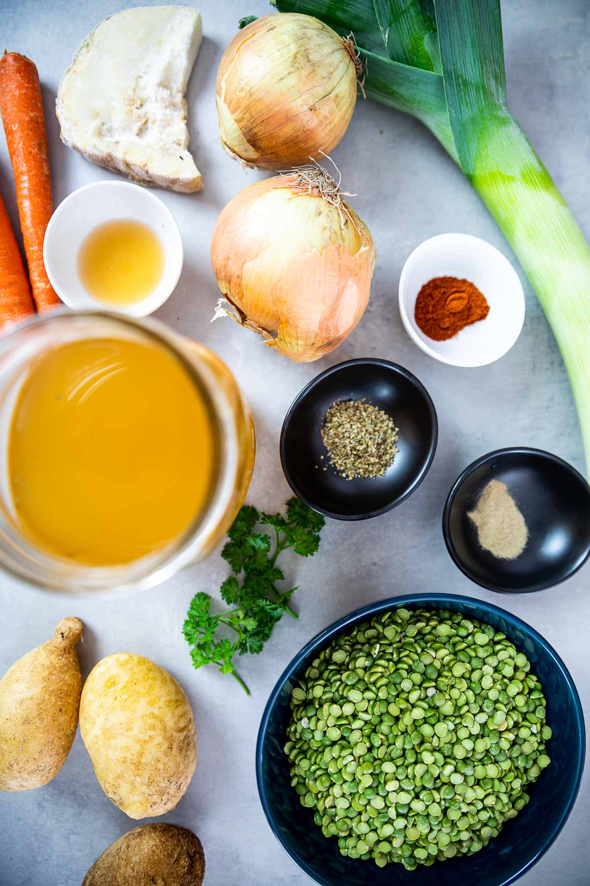 Ingredient shot of vegan split pea soup: Split peas, veggie broth,, celeriac, onions, leek, potatoes, carrots