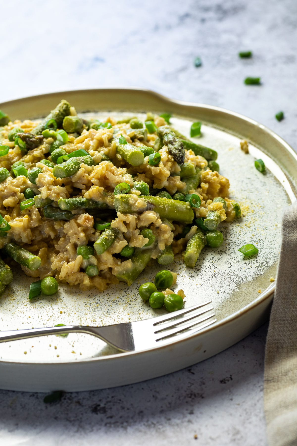 Close up of vegan pea and asparagus risotto on a plate