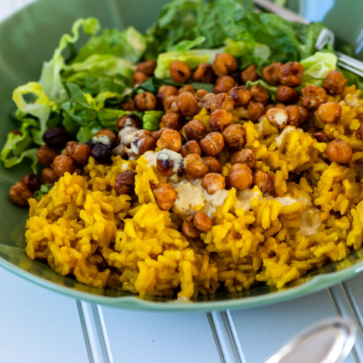 One turmeric rice bowl in the back of another bowl.