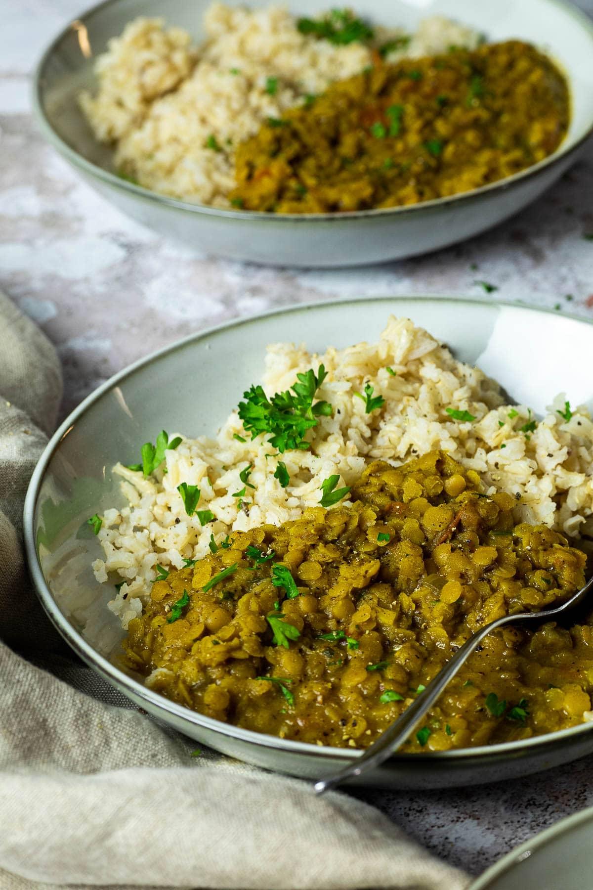 Bowl of vegan red lentil dal in focus