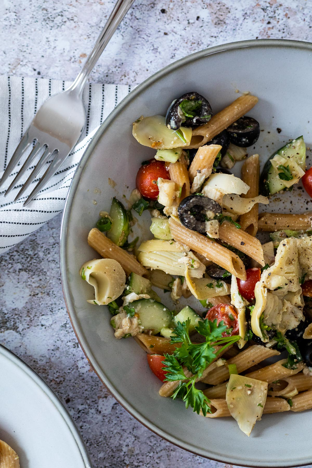 Bird View of vegan pasta salad with artichoke hearts