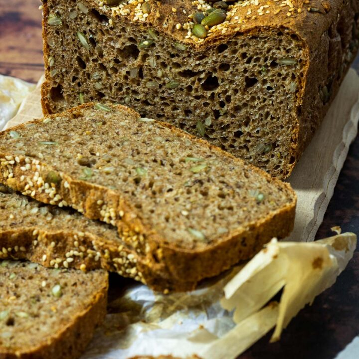 Spelt Bread topped with sesame seeds and pepita seeds cutted side in focus and some slices blurred in front